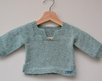 Handmade soft blue knitted cotton baby sweater.