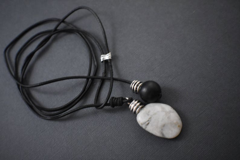 Necklace  Black adjustable leather cord. Natural W/Bk stone image 0