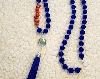 Long necklace of blue crystal beads, orange regalita stone, blue handmade tassel