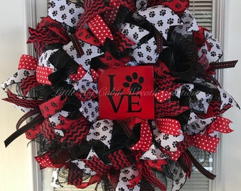 """Dog Love Wreath.  Black, Red, And White Mesh and Ribbon With Love/Paw Sign.  21""""x21""""x6"""""""