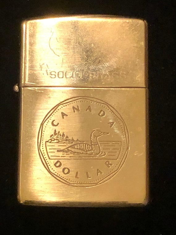 Solid brass 1992 Canadian Dollar Zippo. Lighter not working