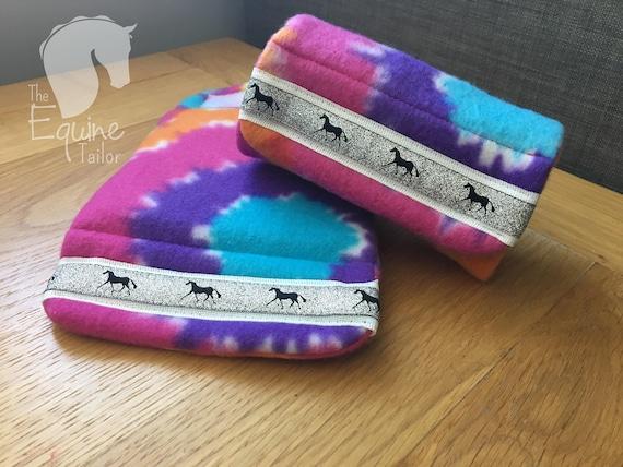 Aqua polar fleece with silver horse ribbon trim Stirrup Bumpers Stirrup covers.