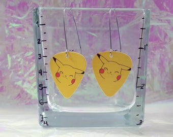Earrings with a pretty yellow Monster electric guitar picks!