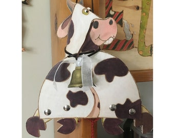 Pull Puppet, Spotted Cow, painted on wood