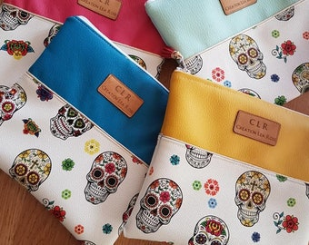 imitation leather pouch Calaveras head of colorful dead; imitation yellow, pink, blue, yellow, golden piping and pompom