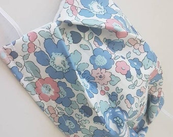 Washable fabric mask with blue and pink liberty betsy fabric nose clamps