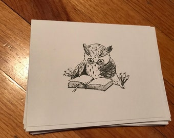 Owl reading a book greeting card. Blank.