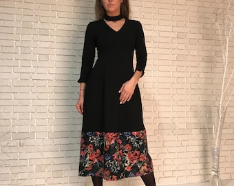 Black knitted dress with a trim of six