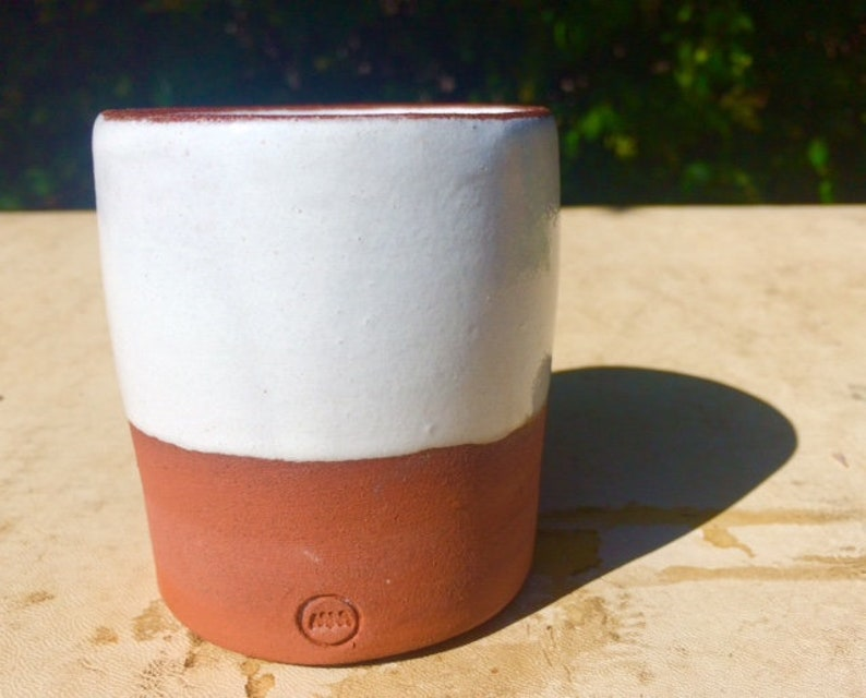 Local clay terracotta pot, ceramics with white glaze