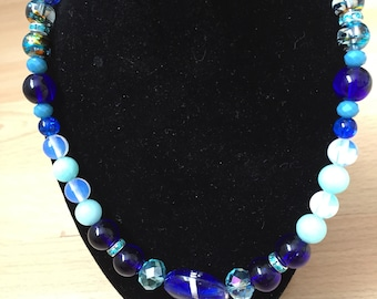 A mix of blues glass and gemstone necklace