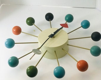 Vintage ball clock styled after iconic George Nelson design multi colored balls