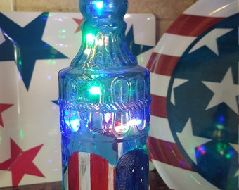 Americana Multi-colorored fairy light bottle 4th of July patio bottle red white and blue heart roses red white and blue flowers rustic