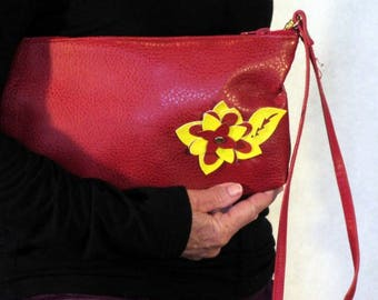 red clutch purse with wristlet strap, zipper closure, pleather