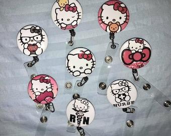 399fb8647 Hello Kitty ID Badge Reel Holder Clip Holder Retractable Nurses Medical  Button Cute