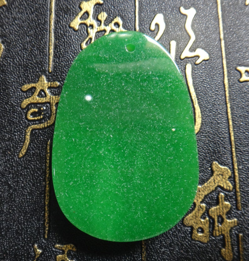 Chinese green jade carved Netherworld Bodhisattva  Patron saint pendant