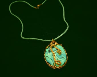 Wire wrapped polymer clay pendant