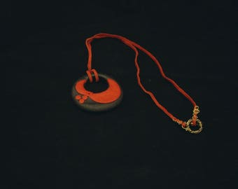 Black and red polymer clay pendant