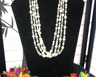Four strand faux pearls with clear crystal beads