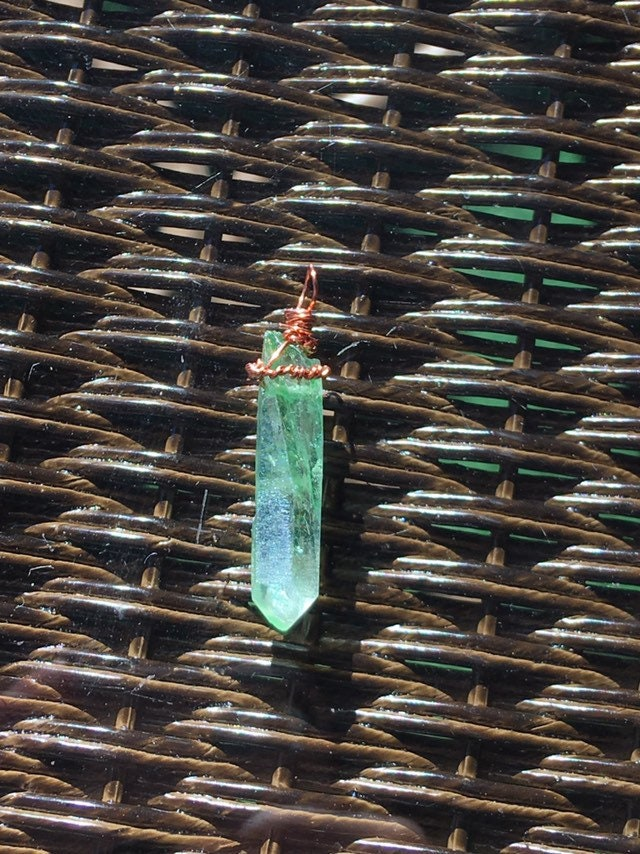 Apple aura quartz is a protective amulet for those who want to drain your energy! Stay protected and heal your heart chakra with this sword..and stone!