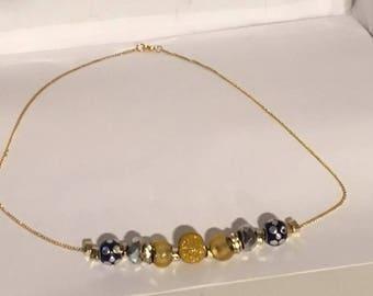 Elegant Blue and Gold Necklace