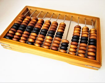 Large Soviet wooden abacus with brown and black wooden moved beads.