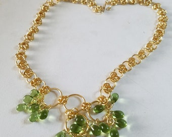 Gold jumprings with green teardrops