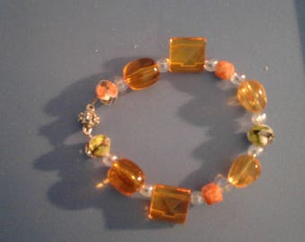 Orange beads with clear beads with green