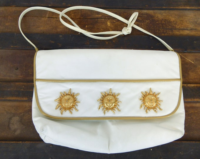 Featured listing image: White Leather Gold Sun Purse, 80s Shoulder Bag, Metal Sunburst Details, Convertible Clutch, Vintage 80s Crossbody, Reem, Made in USA