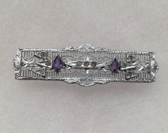 Silver Victorian style filigree with purple & clear stones bar pin.