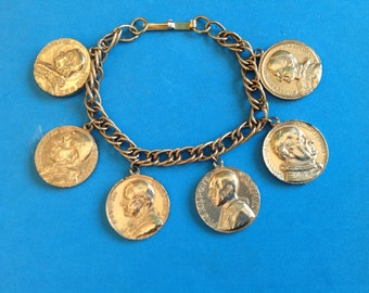 "Catholic 6 popes gold tone charm bracelet 7 1/4"" from p. Pius 1903 - p. Paul 196"