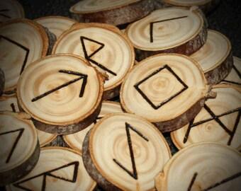Rune set burned on spruce wood