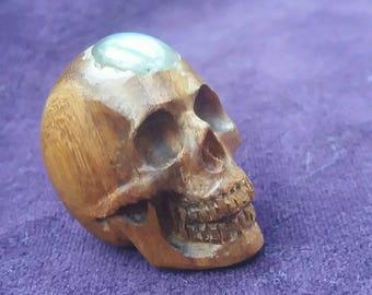 Wood skull with labradoryte stone