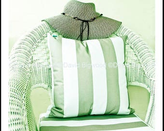 Wicker chair with hat and cushion