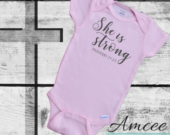 079c44e18 She is Strong Pink bodysuit | Proverbs 31:25 | Christian baby | Infant Girl  Bodysuit | Baby Shower Gift | Religious Outfit | Bible Verse