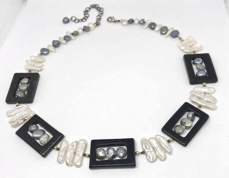 free matching earrings A necklace with white stick pearls and grey pearls in black Onyx frames
