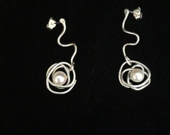 Silver wave and pearl drop earrings