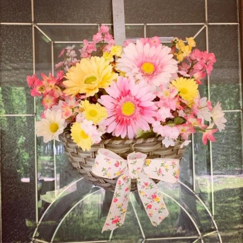 Wicker basket full of cheerful flowers wreath Basket full of image 0