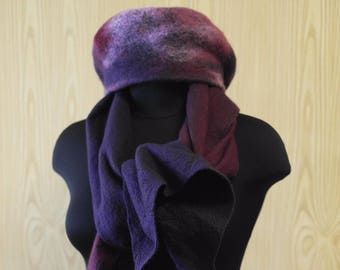 He takes a scarf of Italian fur merino