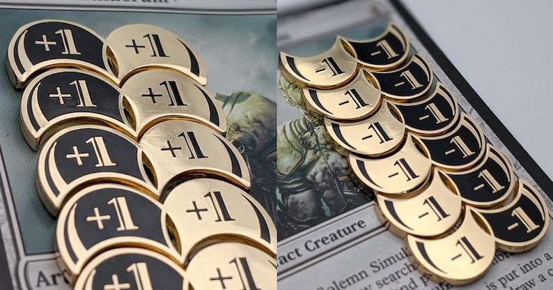 Magic 1/1 Metal Counters: Loyal Strength Reversible Tokens  image 0