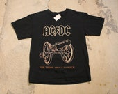 AC DC Music Promo Cannon Graphic Vintage T-Shirt Band Print For Those About To Rock We Salute You Spell Out Graphic