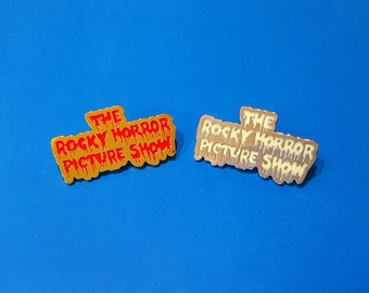 The Rocky Horror Picture Show Enamel and Glow In Dark Luminous Pin Badge