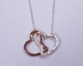 An lovely Pair of unit heart handmadein Rose gold-fill and Sterling silverpendant. 25% Off. Free shipping