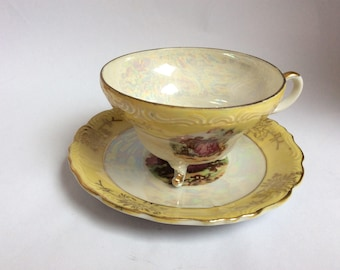 Yellow Teacup and Saucer. Vintage teacup with saucer