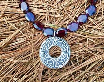 Celtic Warrior Necklace, a Fine Silver oxidized pendant flanked by ten sparkling garnets, 16 inch length, sterling chain with lobster clasp