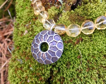 Honeycomb necklace, a Fine Silver oxidized pendant flanked by ten sparkling citrines, 16 inch length, sterling chain with lobster clasp