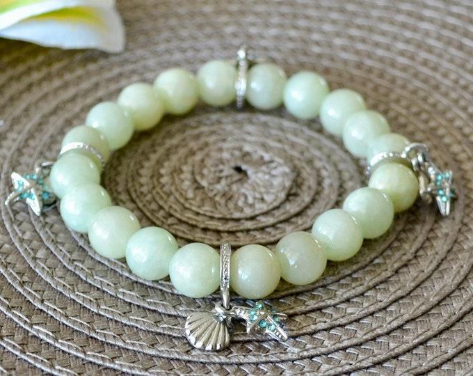 Jade bracelet, Shell bracelet, silver charms, sea star charm, chakra bracelet, wrist mala beads, healing crystals, nephrite bracelet