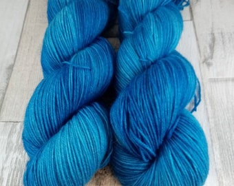 Hand dyed sock yarn in 100g strand color 033 blue