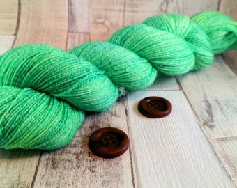 Hand dyed sock yarn in 100g strand with cotton color 305 green