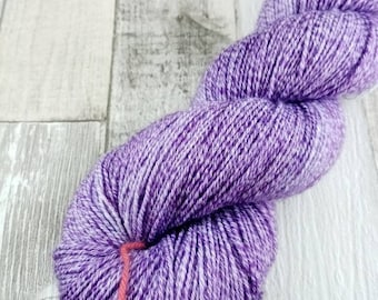 Hand dyed sock yarn in 100g strand with cotton color 426 purple
