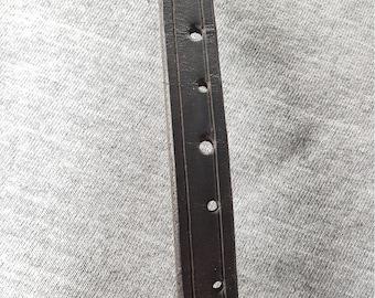 "An elegant black leather bracelet that will fit a 6"" wrist."